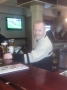 Sean Birt behind the bar in Mullens Pub Cootehill Co Cavan