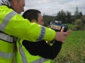 Darren Mc Cabe learning how to use the Speed Camera with Cavan Garda